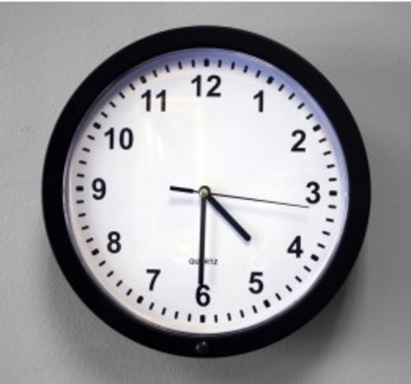 Wall clock with hidden camera